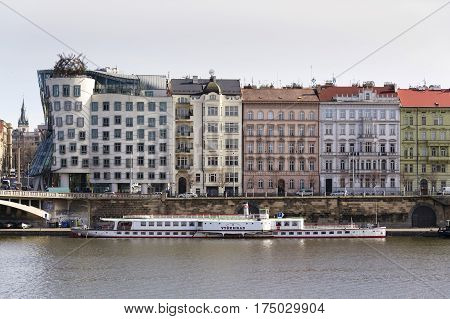 Prague, Czech Republic - March 3: Boat Floating In Front Of The Dancing House, Nicknamed Fred And Gi