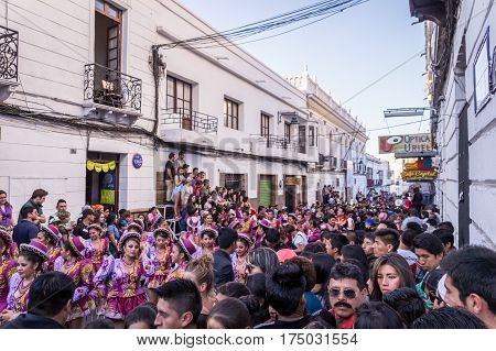 Sucre, Bolivia on September 12, 2015: Full street in center of sucre at parade with Bolivians in costumes at the annual festivity at honor of the virgin of Guadalupe