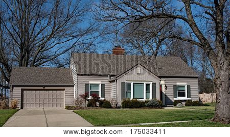 Small Gray House with Garage