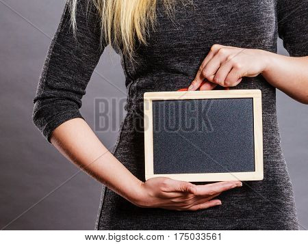 Woman Holding Blank Black Board On Stomach