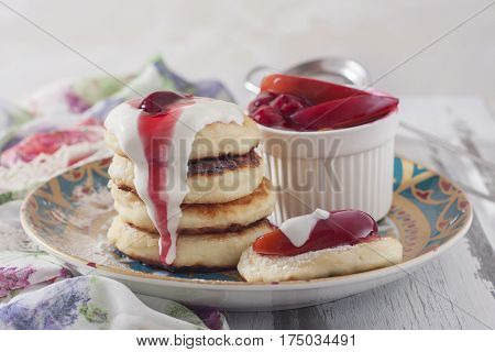Homemade Cottage Cheese Pancakes With Berry-fruit Sauce And Sour