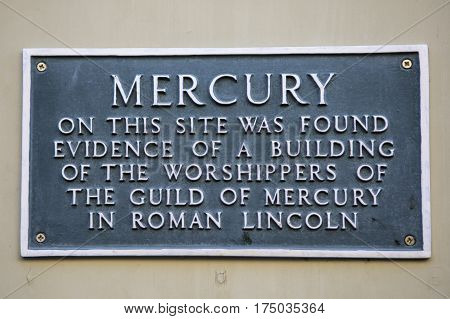 LINCOLN UK - FEBRUARY 28TH 2017: A plaque in the historic city of Lincoln, on 28th February 2017, marking the location where evidence was found of a building of the worshippers of the Guild of Mercury in Roman Lincoln.