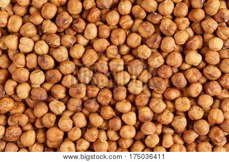 Many delicious hazelnuts as a food background