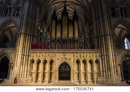 LINCOLN UK - FEBRUARY 27TH 2017: A view of the beautifully sculptured Choir Screen and Organ of Lincoln Cathedral in the historic city of Lincoln UK on 27th February 2017.