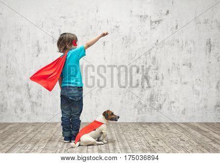 Little hero with dog in studio