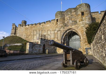 A view of the historic Lincoln Castle in Lincoln UK. The Castle was constructed by William the Conqueror in the 11th Century.