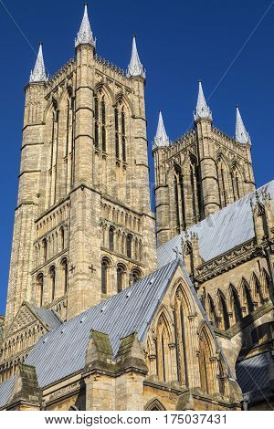 A view of the western towers of Lincoln Cathedral in the historic city of Lincoln UK.