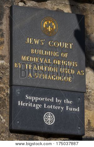 LINCOLN UK - FEBRUARY 28TH 2017: A close-up shot of the plaque on Jews Court in the historic city of Lincoln UK on 28th February 2017.