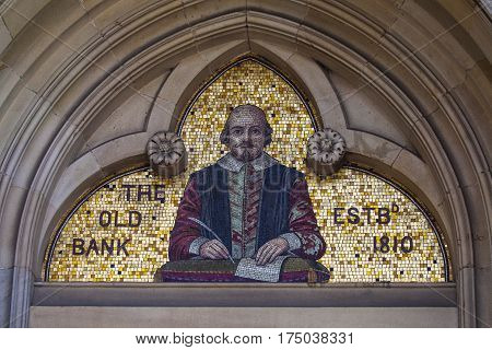 A mosaic of famous playwright and poet William Shakespeare above the entrance to the Old Bank building in Stratford-Upon-Avon in the UK.