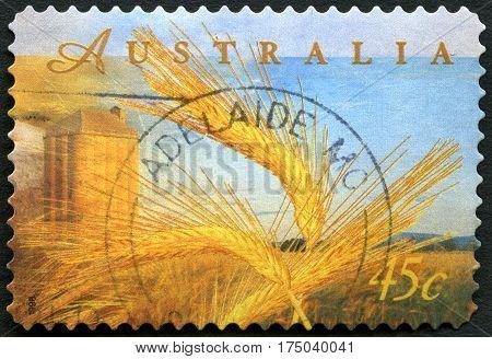 AUSTRALIA - CIRCA 1998: A used postage stamp from Australia depicting an illustration of wheat farming circa 1998.