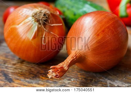 Large onions on a old wooden table