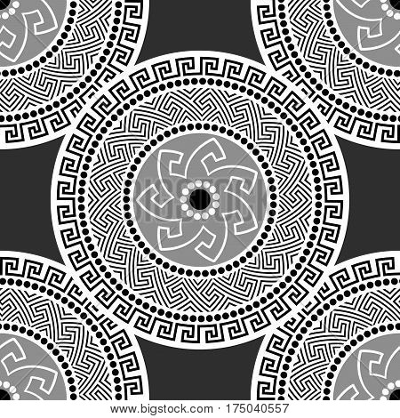 Traditional seamless vintage circle shaped ornate elements with Greek ornament Meander in black and white colors. Can be used for wrapping paper, fabric, ceramic. Vector illustration