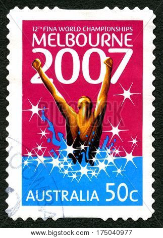 AUSTRALIA - CIRCA 2007: A used postage stamp from Australia commemorating the 12th Fina World Swimming Championships held in Melbourne circa 2007.