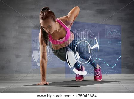 Heart rate monitor concept. Young woman training in gym