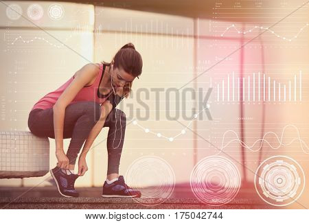 Heart rate monitor concept. Young woman tying shoelaces on morning run