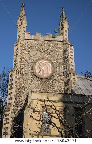 A view of the tower of St. Michael-at-Plea church in Norwich UK. The building is Grade I listed but the church is now redundant.