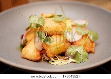 Fish tempura in grey porcelain plate