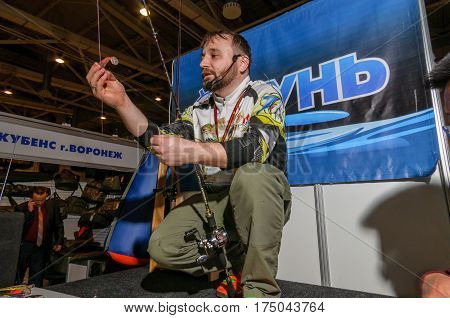 Moscow, Russia - February 25, 2017: Professional fisherman promote wobblers and tackles on the special fishing show in Russia, VDNKh