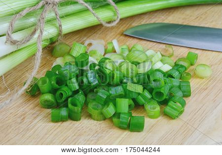 Green onions or Spring onions on wooden board cutting.