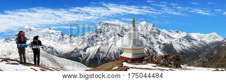 Panoramic view of Annapurna 2 II 3 III 4 IV Ganggapurna and Khangsar Kang from Ice Lake buddhist stupa and tourists way to Thorung La pass Annapurna circuit trek Nepal
