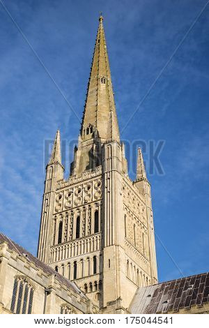 A view of the spire of the magnificent Norwich Cathedral in the historic city of Norwich UK.