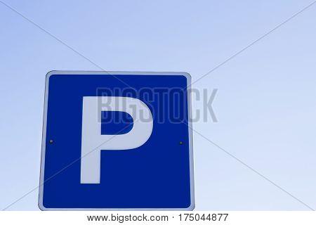 The Parking lot blue Parking sign against blue sky