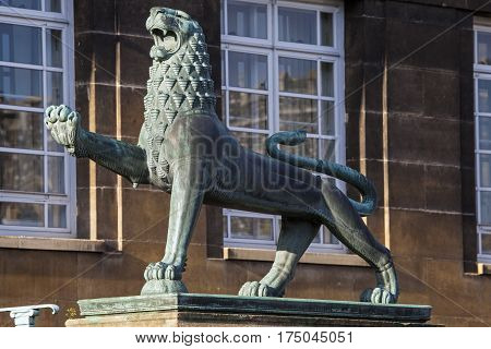 A heraldic lion outside the entrance to Norwich City Hall in the historic city of Norwich UK.