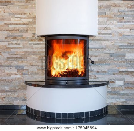 An interior shot of a modern marble fireplace in living room