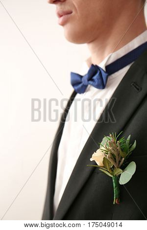 Closeup view of groom with beautiful boutonniere