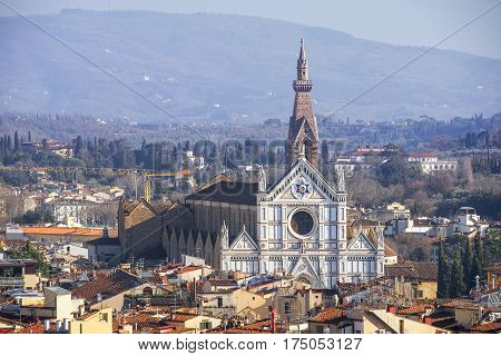 view of the Basilica di Santa Croce through the roofs of the old Florence, Italy
