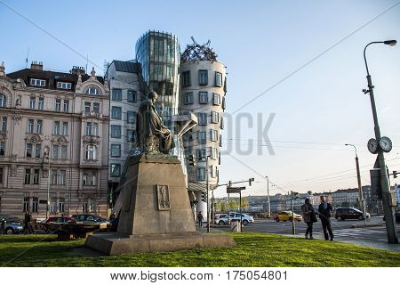 Prague Czech Republic 11.04.2014: Dancing House and the monument of Alois Jirasek