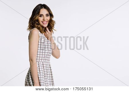 Beautiful female model with brown hair and brown eyes.The picture was taken in a studio on a white background.