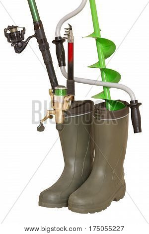 Fishing concept: fishing rods and hand ice drill in rubber boots on a white background