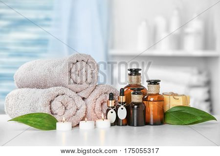 Table with beautiful spa composition on blurred background