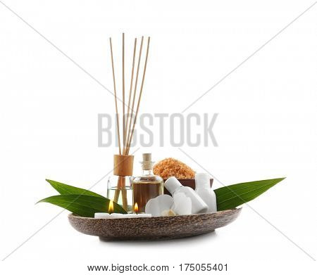 Plate with beautiful spa composition on white background