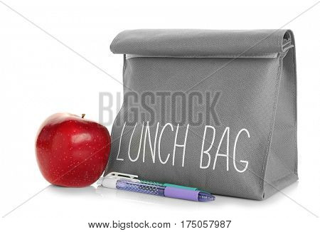 Modern lunch bag and appetizing apple on white background