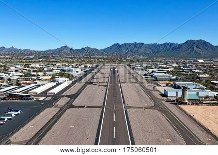 Looking northeast from above the runway in Scottsdale Arizona at the McDowell Mountains