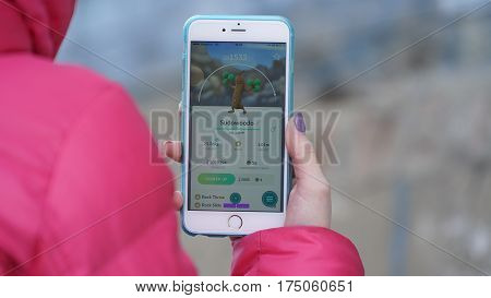 Samara, Russia - March 7, 2017: woman playing pokemon go on his iphone 6s Plus. pokemon go multiplayer game with elements of augmented reality. Sudowoodo was caught. Second generation of Pokemon