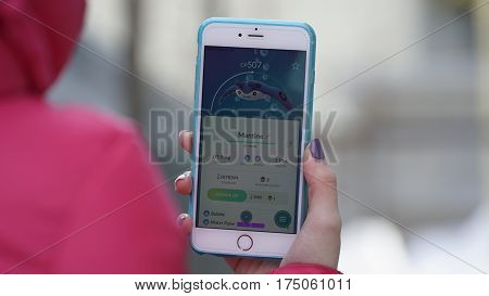 Samara, Russia - March 7, 2017: woman playing pokemon go on his iphone 6s Plus. pokemon go multiplayer game with elements of augmented reality. Mantine was caught. Second generation of Pokemon
