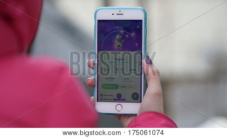Samara, Russia - March 7, 2017: woman playing pokemon go on his iphone 6s Plus. pokemon go multiplayer game with elements of augmented reality. Togetic was caught. Second generation of Pokemon