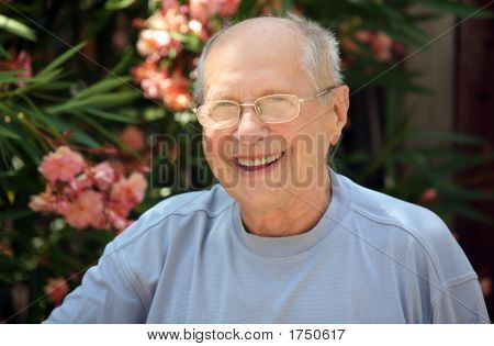Old man laughing on a sunny day poster
