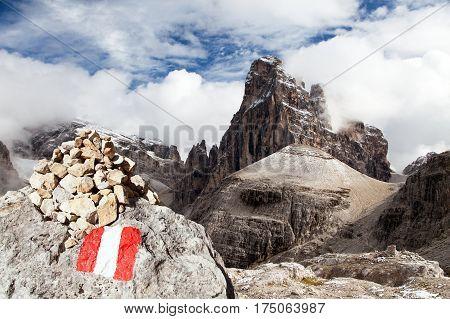 Croda Berti and tourist sign with stone pyramid Sextener Dolomiten or Dolomiti di Sesto Italy