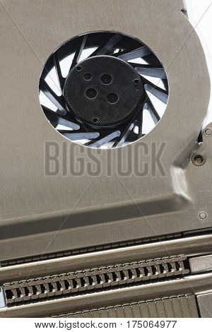 Detail of metal and plastic fan cooling system for computers