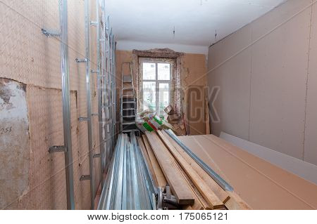 Interior of apartment with materials during on the renovation and construction ( remodel wall from gypsum plasterboard)