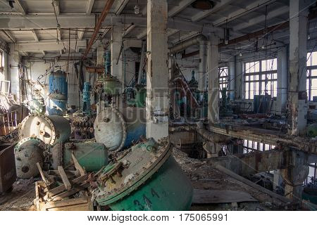 The abandoned chemical pharmacy vitamin plant with the remains of equipment, rusty tanks