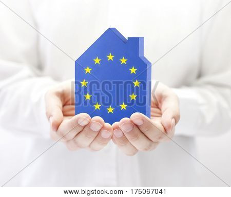 House with European Union flag in hands