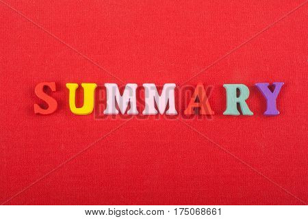 SUMMARY word on red background composed from colorful abc alphabet block wooden letters copy space for ad text. Learning english concept