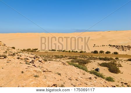 Image of an off-road car in the Oued Aoreora which is the entry to the piste Plage Blanche, Morocco.