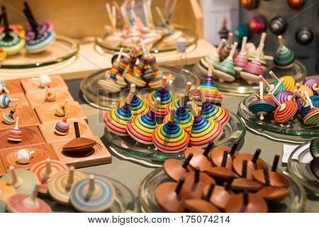 Colorful wooden spinning tops on market stall