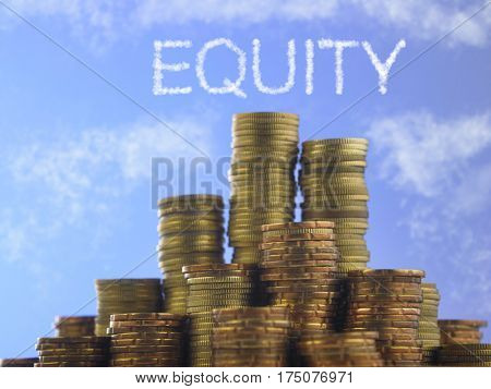 Many piles of coins against  blue sky with text equity